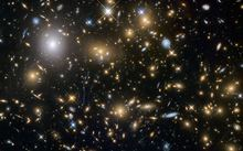 Astronomers use the Hubble Space Telescope and Albert Einstein's General Theory of Relativity to obtain gravitational lensing images of galaxy cluster.