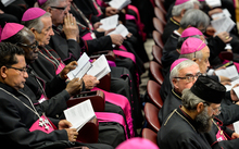 Bishops hold books as the Pope reads prayers at the morning session of the last day of the Synod on the Family at the Vatican.