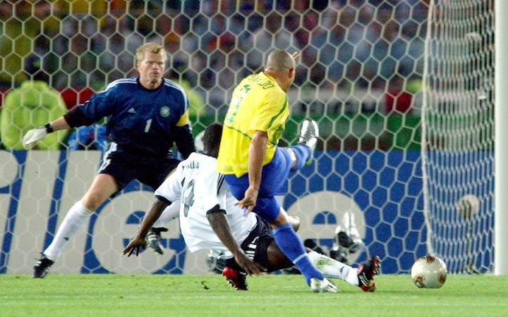 Brazilian forward Ronaldo kicks the ball and scores the 2-0 lead in the 2002 World Cup final.