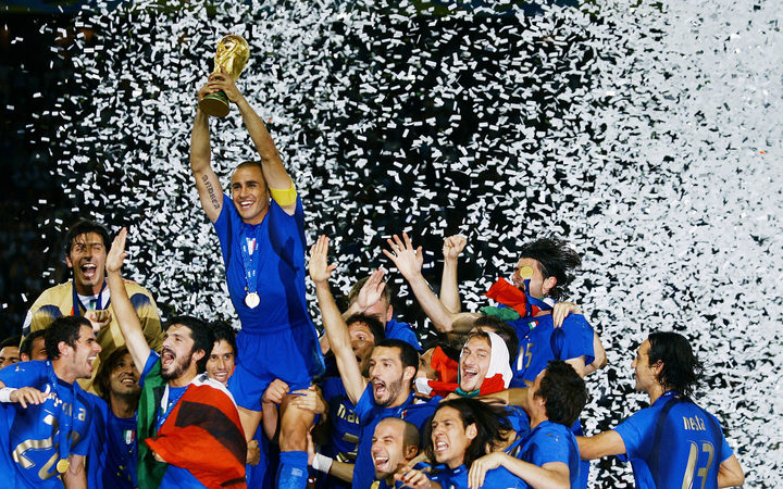 Italy captain Fabio Cannavaro lifts the trophy of the 2006 Fifa World Cup after the final match against France at Berlin Olympic Stadium.