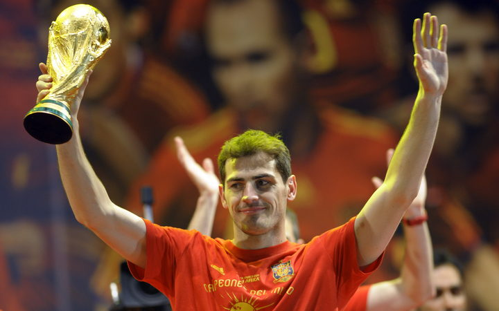 Spain's goalkeeper Iker Casillas holds up the trophy on a stage set up for the Spanish team victory ceremony in Madrid on July 12, 2010.