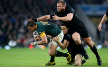 Handre Pollard of South Africa is tackled by Sonny Bill Williams