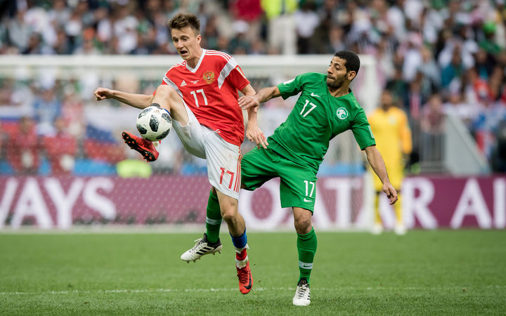 Aleksandr Golovin of Russia fields the ball against Saudi Arabia in the World Cup opener.