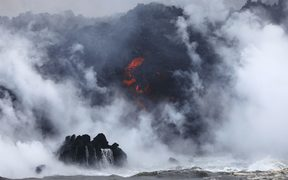 A steam plume rises as lava enters the Pacific Ocean, after flowing to the water from a Kilauea volcano fissure.