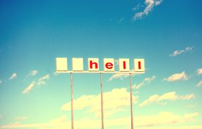 "Abandoned Shell petrol station sign with logo and first letter missing - now reading ""hell"""