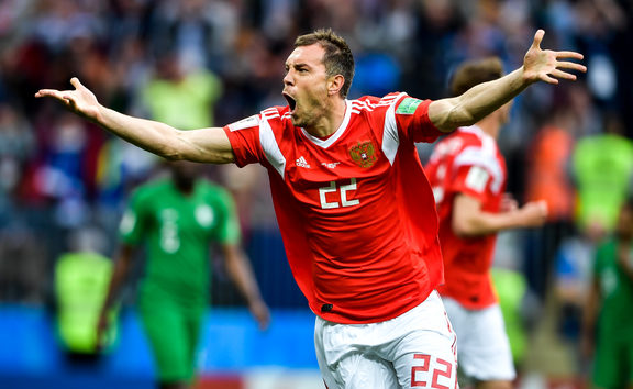 Artem Dzyuba of Russia celebrates after scoring a goal against Saudi Arabia in their Group A match during the 2018 FIFA World Cup in Moscow, Russia, 14 June 2018.
