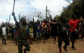 Angry tribesman take to the streets in Mendi in Papua New Guinea.