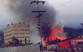 A building burns in Mendi during a period of political unrest.