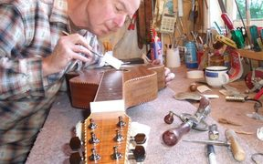 Luthier Paddy Bergin working on one of his home-made guitars