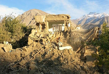 Afghan residents examine a damaged house in Raman Kheel in the Panjshir Valley after the deadly 7.5 magnitude earthquake on 26 October 2015.