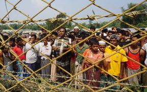 Rohingya Muslims gather behind Myanmar's border lined with barbed wire fences in Maungdaw district, located in Rakhine State bounded by Bangladesh.
