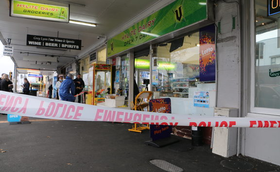 Police cordon off the scene at Grey Lynn supprette, Hylite Dairy after a mother and son were stabbed.