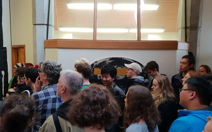 Dozens packed a small corridor outside the Dean of the Creative Arts and Industries department on 21 June to protest against the closure of three specialist libraries on University of Auckland's campus.