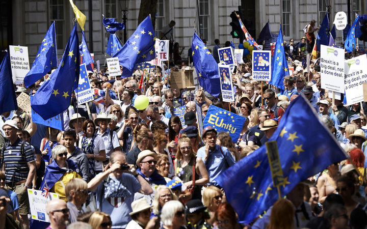 Demonstrators carry banners and flags as they participate in the People's March demanding a People's Vote on the final Brexit deal.