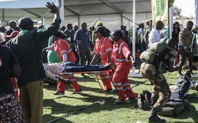 Injured people are evacuated after an explosion at the stadium in Bulawayo where Zimbabwe President just addressed a rally.