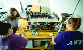 Lauren Tennent and two inmates on Trade School Industries' barista training course, Arohata prison.