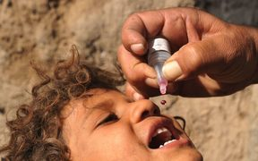 A child is immunised against the disease.