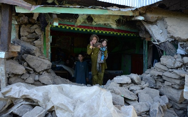 Quake victims seek shelter after their home was destroyed.