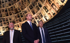 Britain's Prince William, Chief Rabbi Ephraim Mirvis of the United Congregations of the Commonwealth (L) and chairman of Yad Vashem Avner Shalev, tour the Yad Vashem Holocaust memorial in Jerusalem on 26 June, 2018.