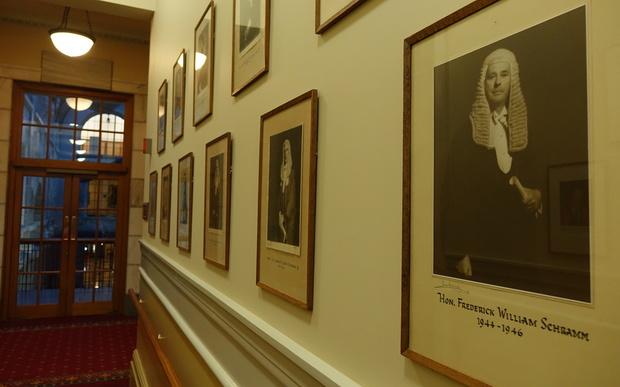 Most of the framed photos on the walls of Parliament show white, middle-aged men.