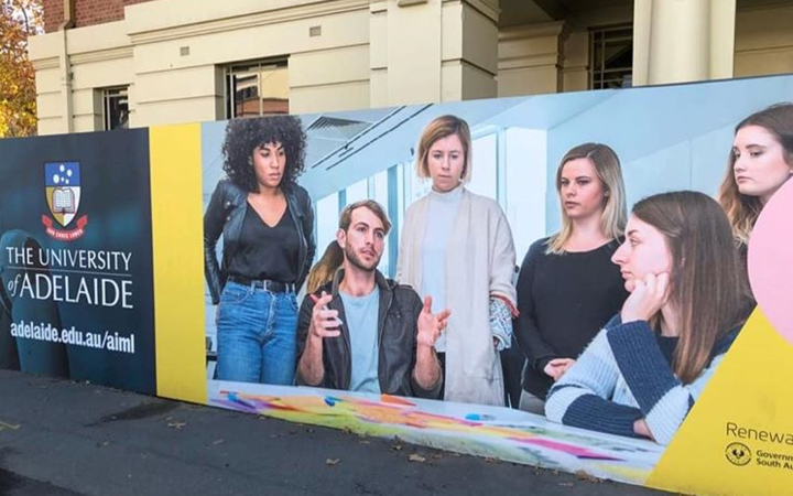 Poster outside Australian university mocked for 'mansplaining'