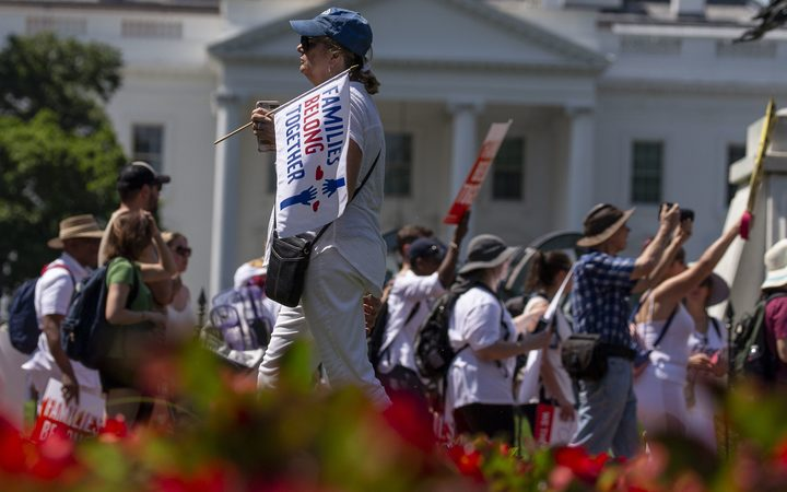 Demonstrators in front of the White House prior to a march against the separation of immigrant families.