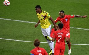 Colombia's defender Yerry Mina (C) vies with England's forward Raheem Sterling (R) during the Russia 2018 World Cup round of 16 football match between Colombia and England at the Spartak Stadium in Moscow on July 3, 2018.