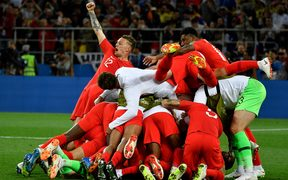 England's players celebrate winning the penalty shootout at the end of the Russia 2018 World Cup round of 16 football match between Colombia and England.