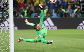 England's Goalkeeper Jordan Pickford stops Colombia's Carlos Bacca's kick in a penalty shootout.