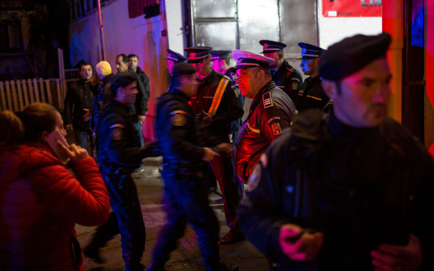 Emergency service and police forces gather near a club in Bucharest.
