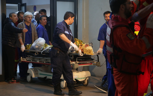 A victim of the fire at a club is transported to an emergency hospital in Bucharest