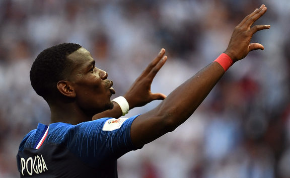 France's midfielder Paul Pogba celebrates France's victory at the end of the Russia 2018 World Cup round of 16 football match between France and Argentina at the Kazan Arena in Kazan on June 30, 2018.