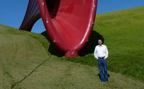 Martin Lodge at The Farm sculpture park, Kaipara Harbour, with Dismemberment 1 by Anish Kapoor, 2011