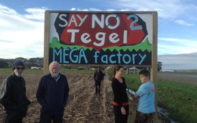 The roadside signs against the Tegel farm were painted by a local artist.