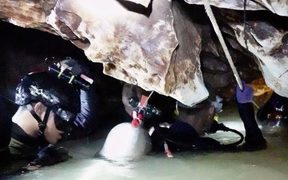 Cave divers in Thailand.
