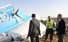A picture released by Egypt's Prime Minister's office which shows PM Sherif Ismail (right) at the site of the wreckage.