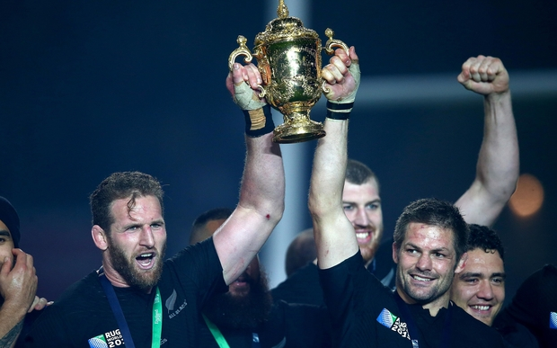 All Blacks Kieran Read, left, and Richie McCaw lift the Webb Ellis cup