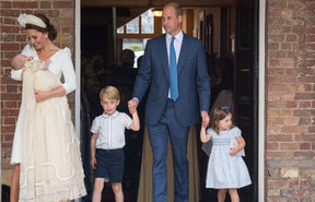 Britain's Princess Charlotte of Cambridge and Britain's Prince George of Cambridge hold hands with their father, Britain's Prince William, Duke of Cambridge, as Britain's Prince Louis of Cambridge is carried by his mother, Britain's Catherine, Duchess of Cambridge.