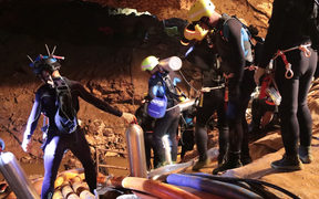 Photo taken recently by the Royal Thai Navy on 7 July, 2018 shows a group of Thai Navy divers in Tham Luang cave during rescue operations for the 12 boys and their football team coach trapped in the cave.