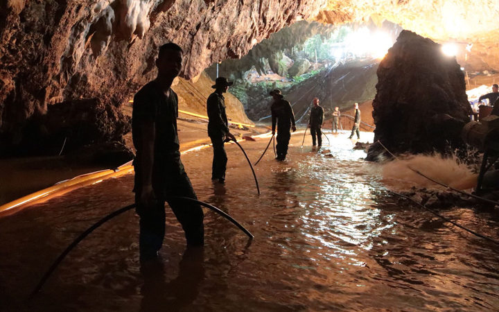 A Royal Thai Navy image on 7 July, 2018 shows Thai Navy soldiers in the flooded Tham Luang cave during rescue operations for the 12 boys and their football team coach trapped in the cave.