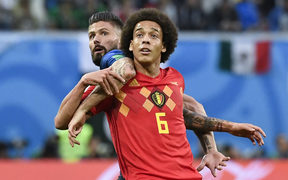Belgium midfielder Axel Witsel (right) vies with France's forward Olivier Giroud during the Russia 2018 World Cup semi-final football match between France and Belgium at the Saint Petersburg Stadium.