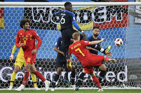 France's midfielder Paul Pogba (at top) vies with Belgium's midfielder Kevin De Bruyne (2R) during the Russia 2018 World Cup semi-final football match between France and Belgium at the Saint Petersburg Stadium.