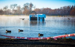 A campervan with five passengers wound up in Henley Lake, Masterton.