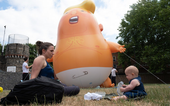 British activists created a giant baby Trump balloon to take part in protests against the US president in London on 13 July.