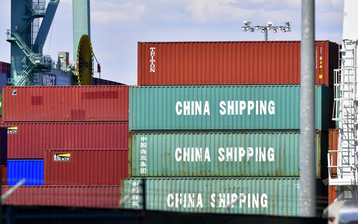 Containers are stacked on a vessel at the Port of Long Beach in Long Beach, California on July 6, 2018, including some from China Shipping, a conglomerate under the direct administration of China's State Council.