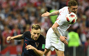 Croatia's midfielder Ivan Rakitic (L) vies for the ball with England's defender Kieran Trippier during the Russia 2018 World Cup semi-final football match between Croatia and England at the Luzhniki Stadium in Moscow on July 11, 2018.