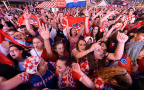 Croatia's supporters react as they watch on a giant screen the Russia 2018 World Cup semi-final football match between Croatia and England, at the main square in Zagreb on July 11, 2018.