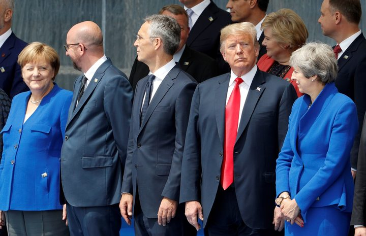 From left German Chancellor Angela Merkel Belgium's Prime Minister Charles Michel NATO Secretary General Jens Stoltenberg US President Donald Trump and Britain's Prime Minister Theresa May attend the opening ceremony of the Nato summit in Brussels