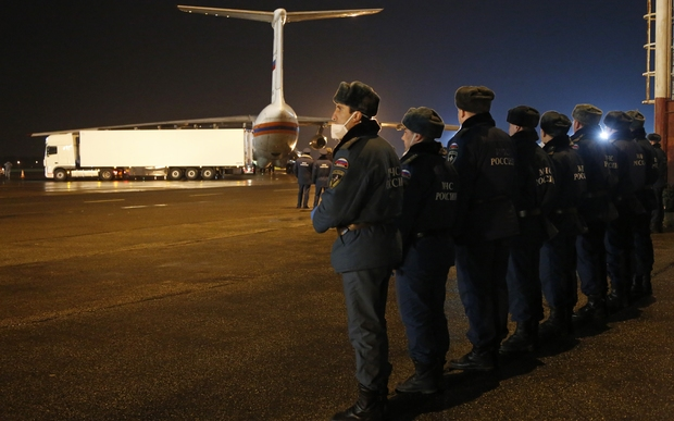 Russian Ministry for Emergency Situations employees prepare to load the bodies of the victims from the ministry's plane at the airport in St Petersburg.