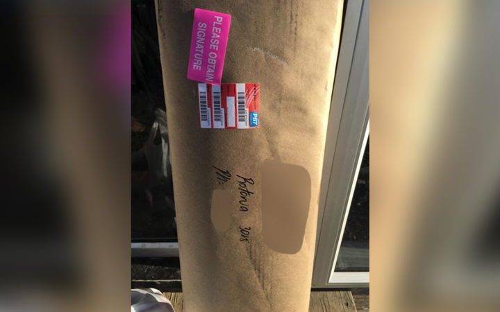 A PBT Couriers driver left this package, with a gun inside, leaning next to the front door because no one was home.